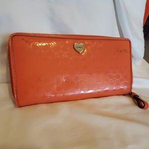 Coach orange accordion zip wallet